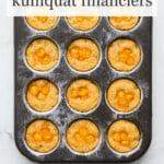 A muffin pan of sesame kumquat financiers garnished with thinly sliced kumquats