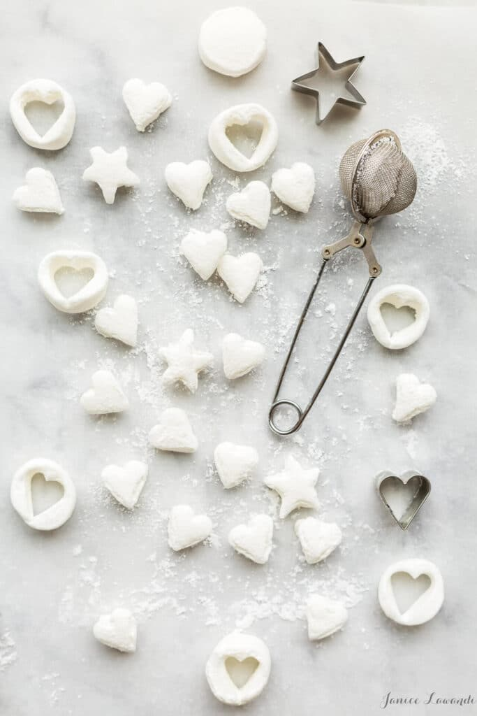Cutting out marshmallows into mini hearts which can be used as toppings for chocolate pots de crème or hot chocolate