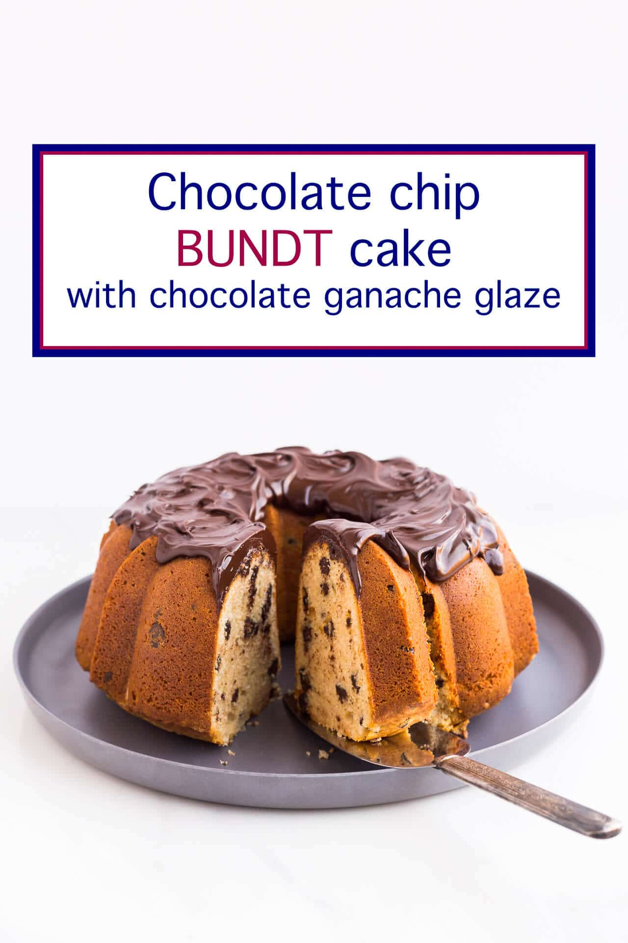 Bundt cake with chocolate chips and swirls of thick chocolate glaze being sliced and served from a grey serving platter