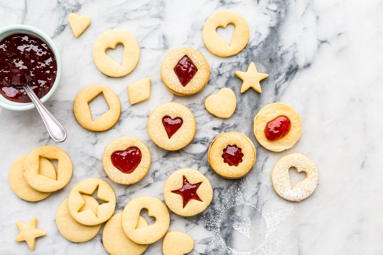 Classic holiday shortbread cutout cookies with strawberry jam filling