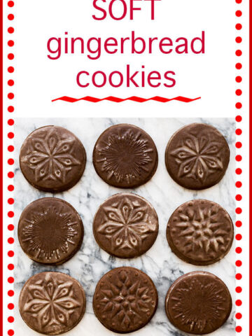 Nine dark gingerbread cookies stamped with star shapes and lightly glazed for a shimmery finish