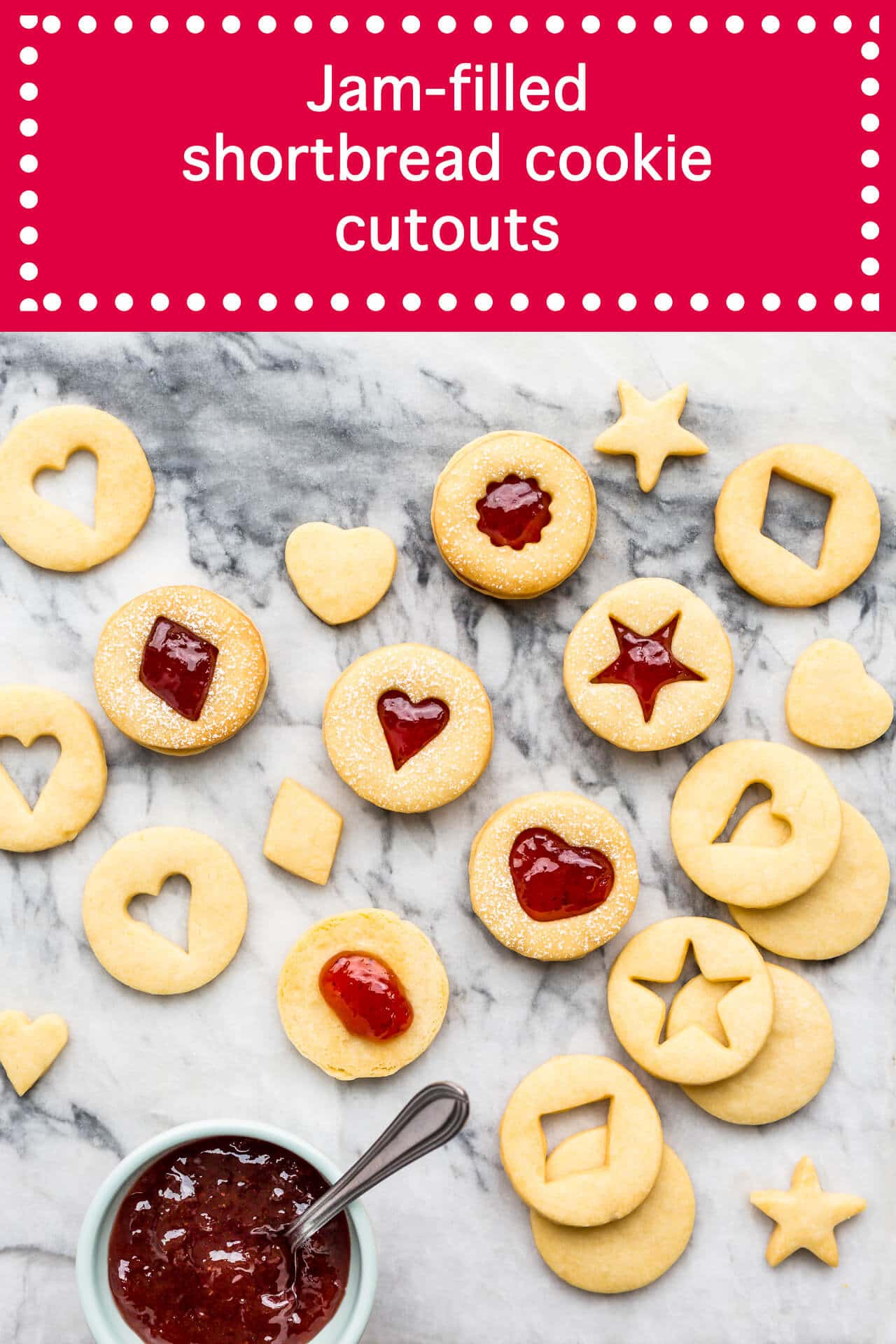 jam filled shortbread cutout cookies that hold their shape sandwhiched with strawberry jam and a bowl of jam with a spoon
