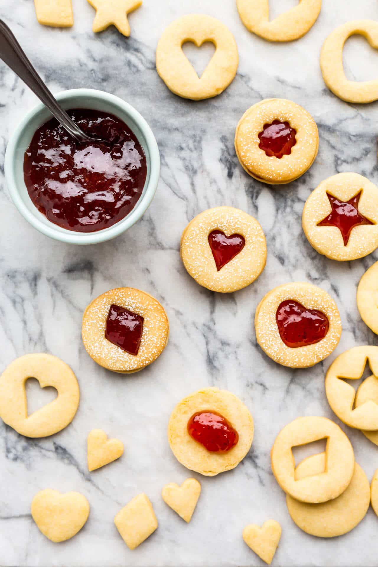 shortbread cutout cookies sandwiched with strawberry jam filling