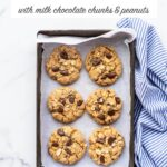 Thick chewy oatmeal chocolate chunk cookies with milk chocolate and salted peanuts