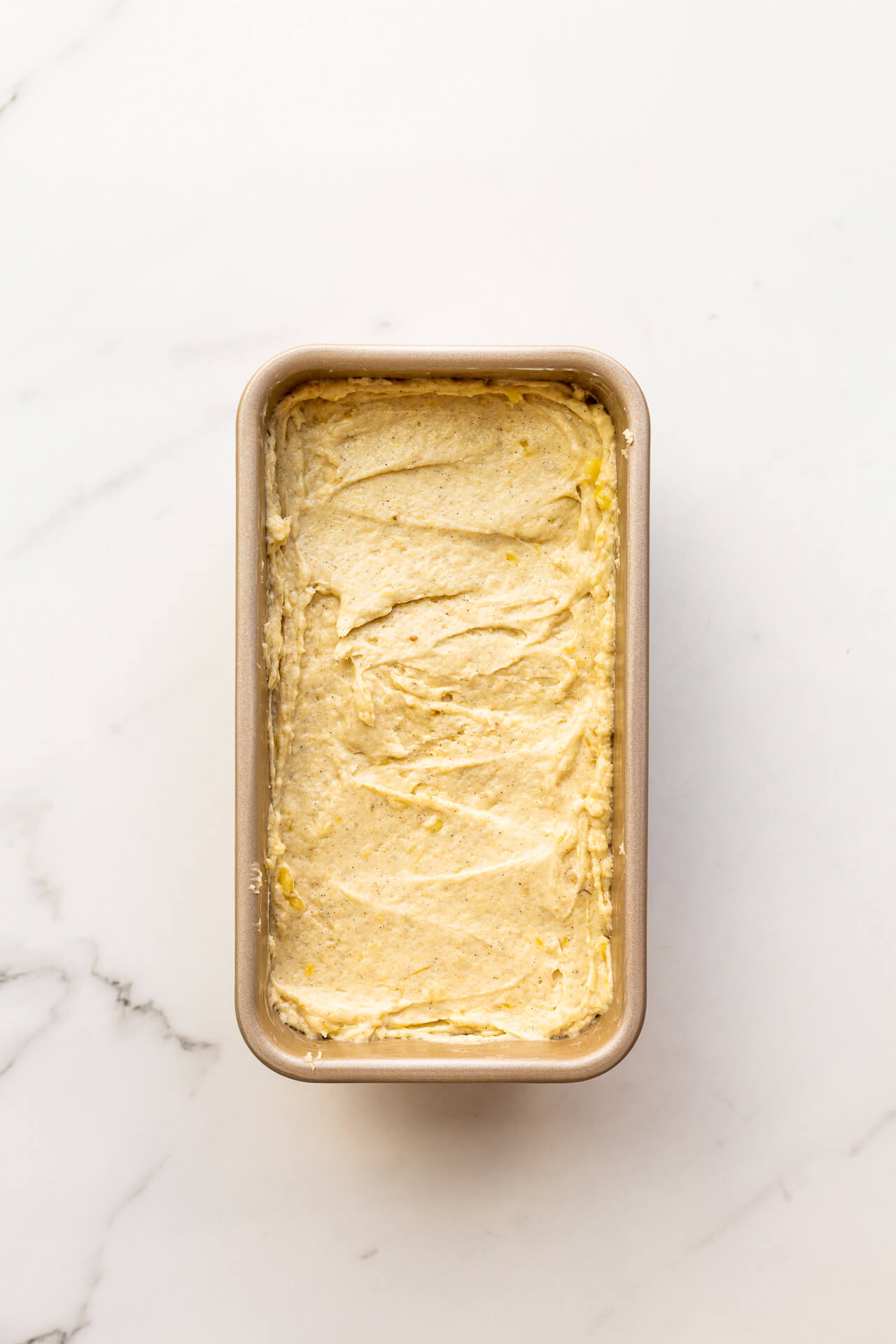 Banana bread cake batter in a loaf pan ready for the oven