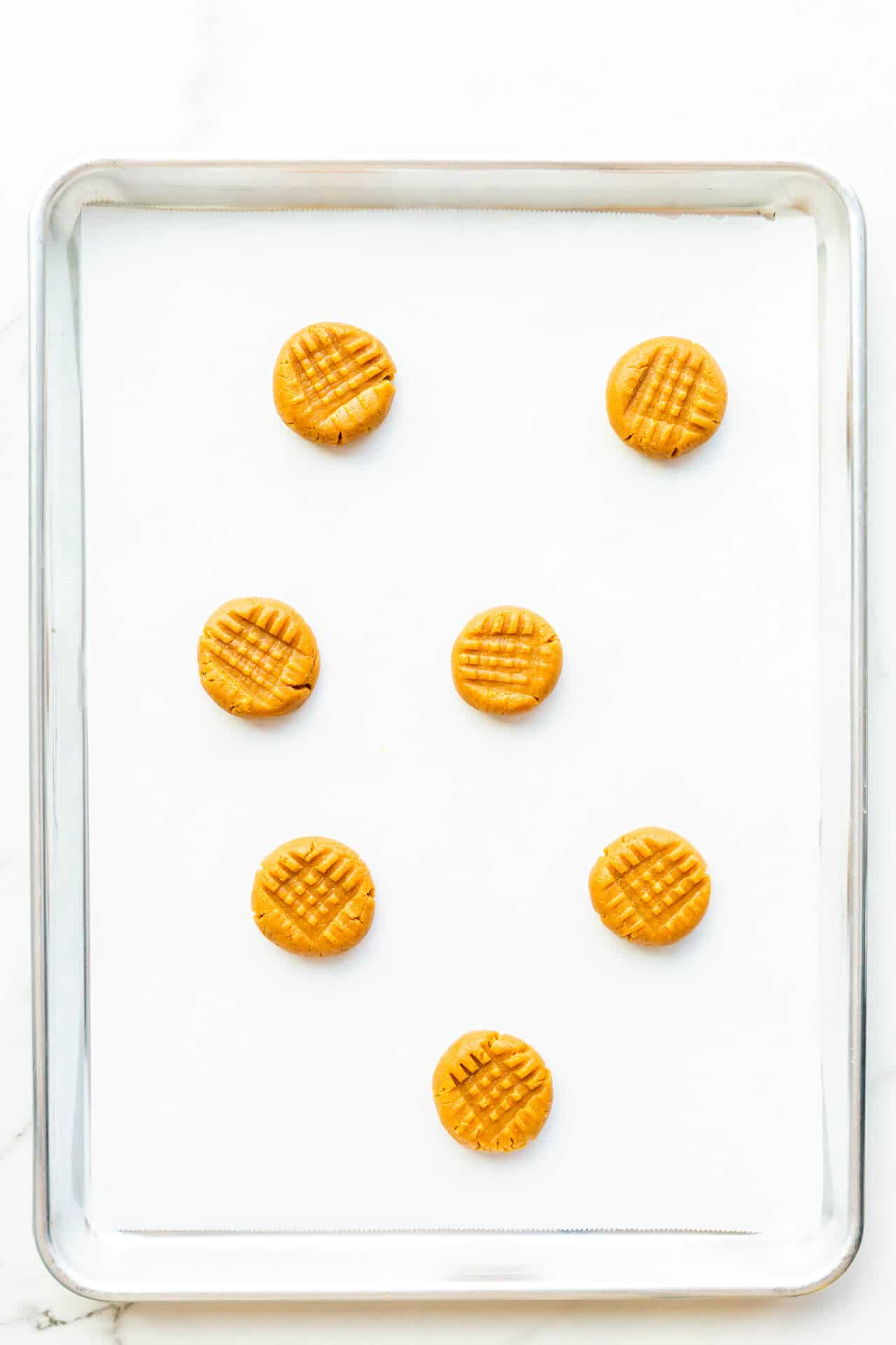 Flourless peanut butter cookies with criss cross pattern