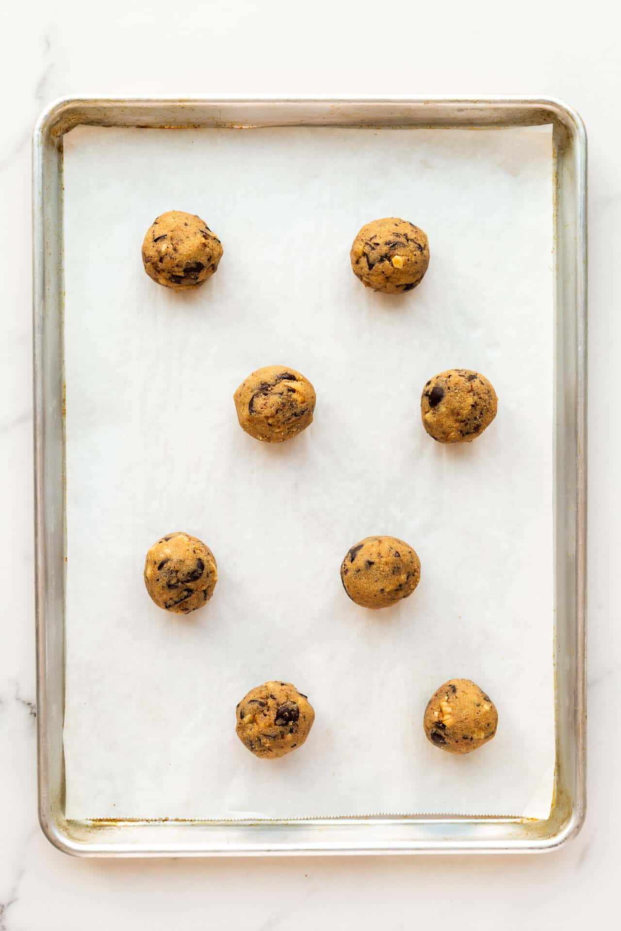 Portioned out spelt chocolate chip cookie ready to be baked