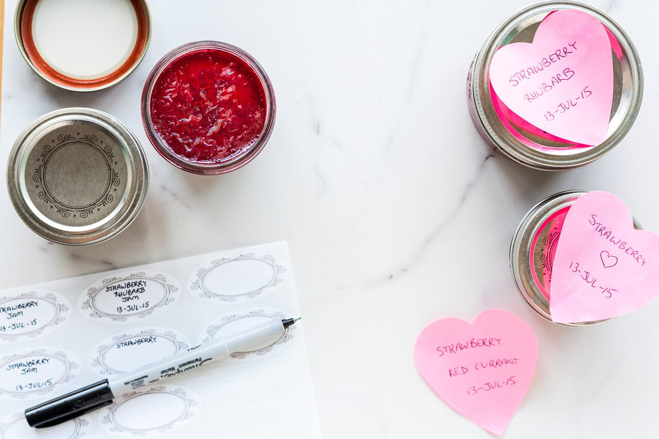 Labelling jars of jam with stickers to identify them (or heart shaped post-it notes)