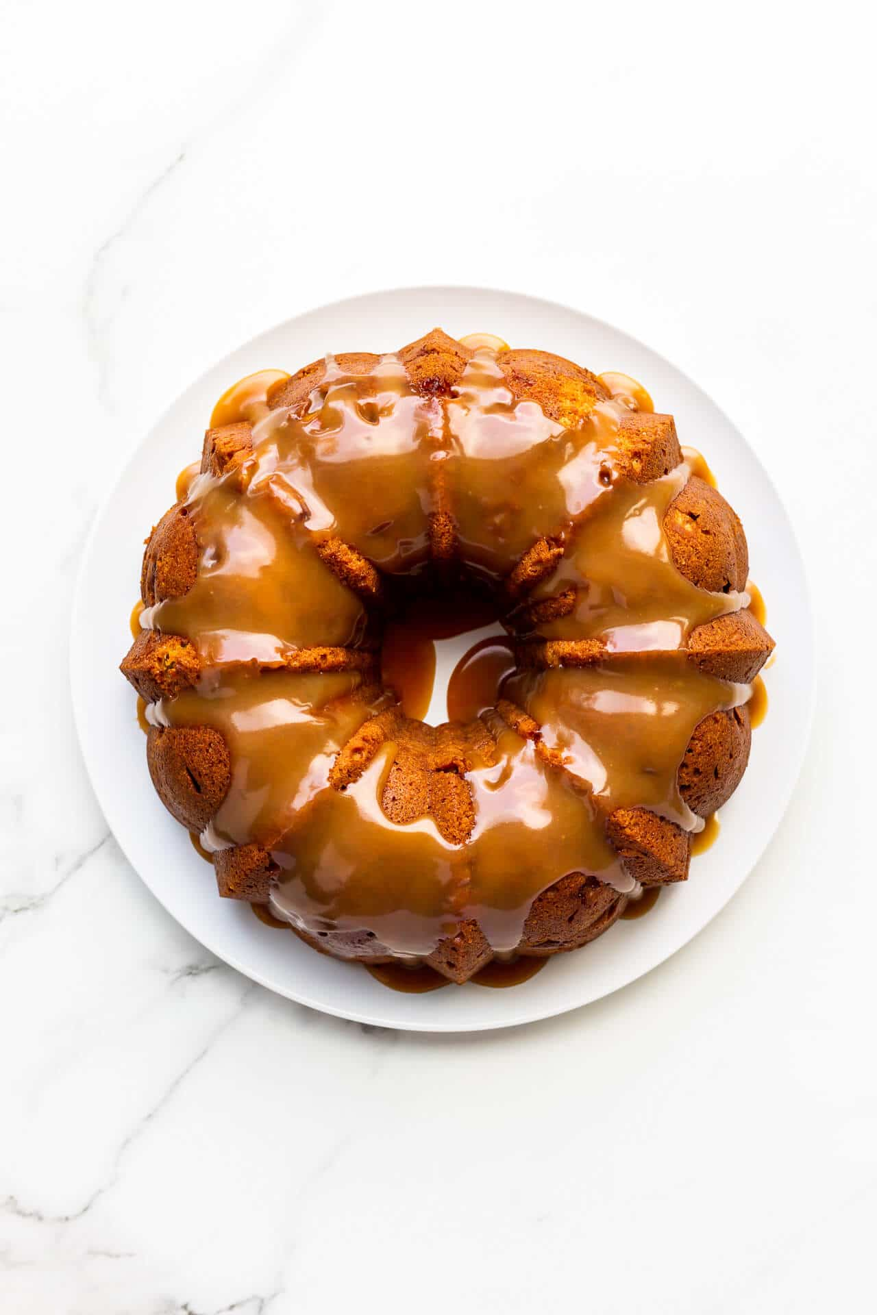 Bundt cake coated with shiny salted caramel sauce
