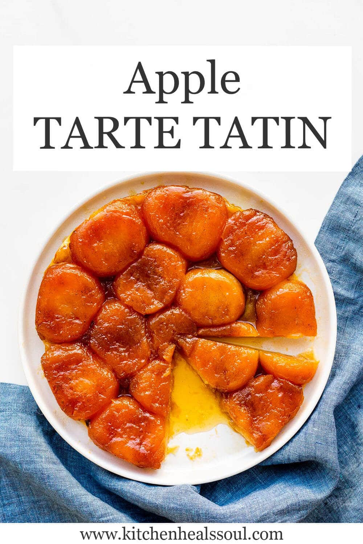 Apple tarte tatin sliced on a beige plate with blue jean linen