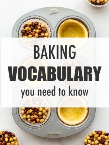 Blind baked tart shells in a muffin pan with silicone liners and dried beans to illustrate baking vocabulary you need to know.