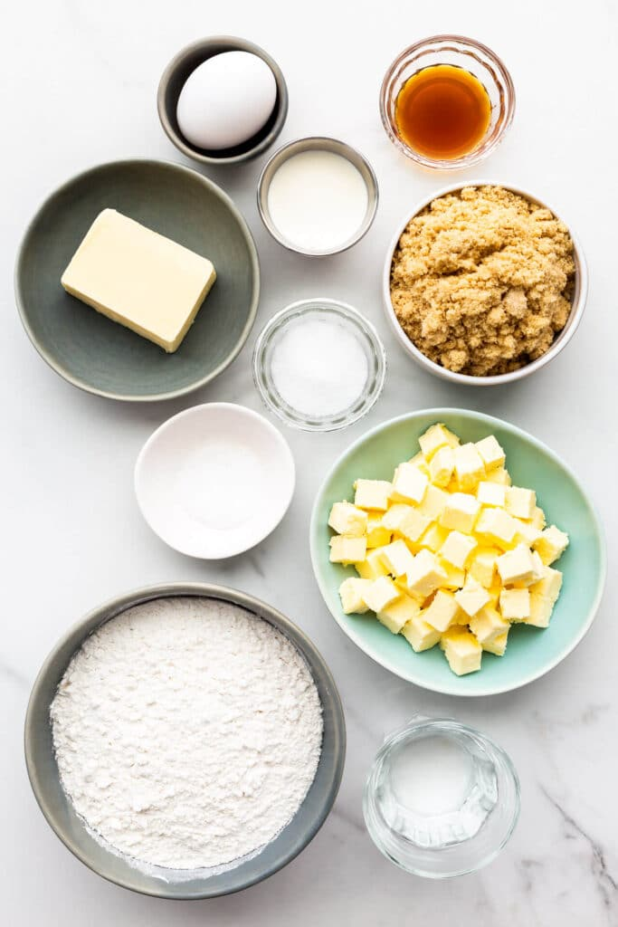 Ingredients to make butter tarts from scratch measured out, including ingredients to make both the crust and the filling.