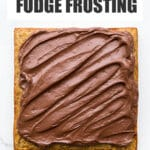 Chocolate fudge frosting on a square banana cake.