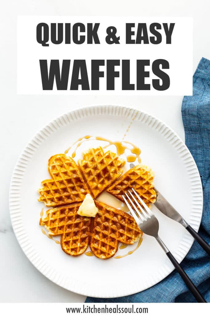 Plate of plain waffles with maple syrup and butter.