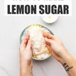 Rubbing lemon zest into granulated sugar with fingertips in a bowl to make lemon sugar.