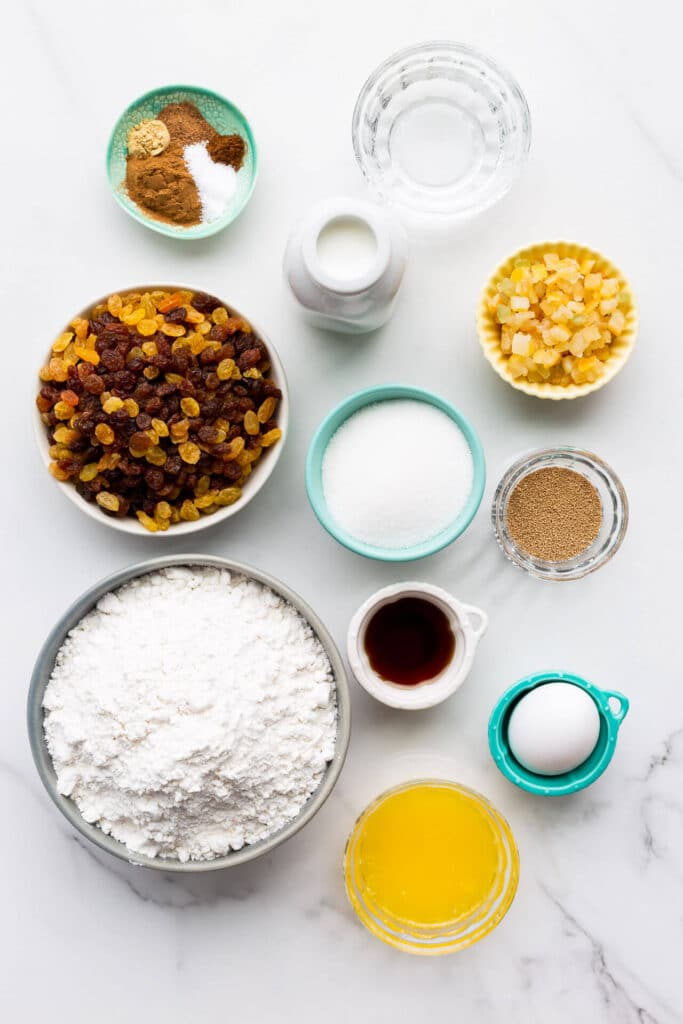 Ingredients measured out to make hot cross buns from scratch.