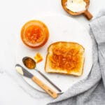 Homemade thick cut orange marmalade spread on toast with butter.