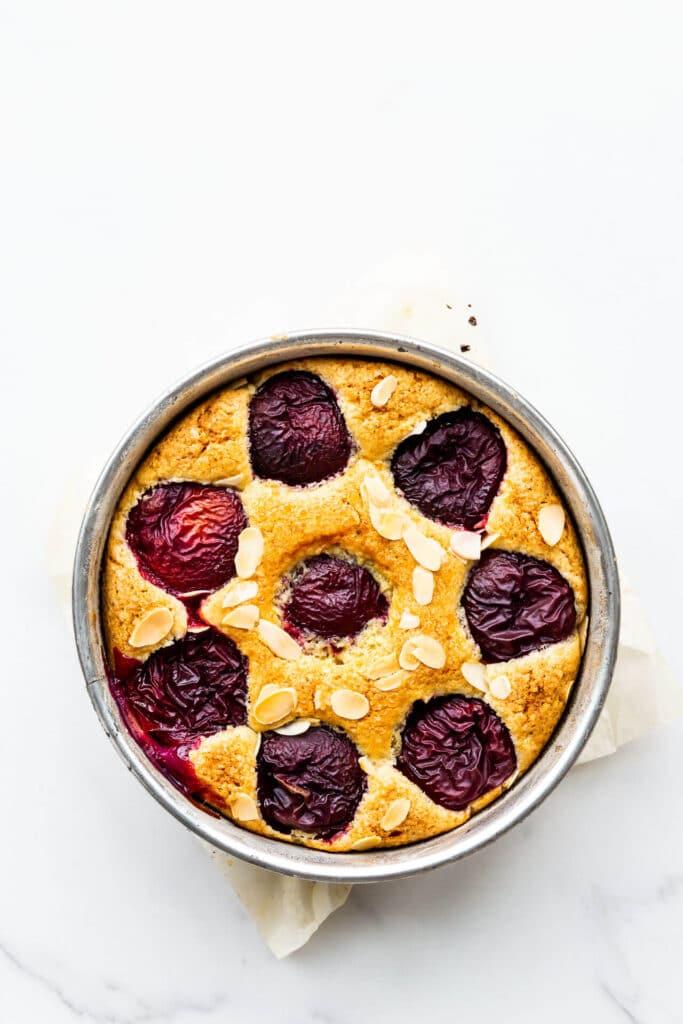 Freshly baked plum cake cooling.