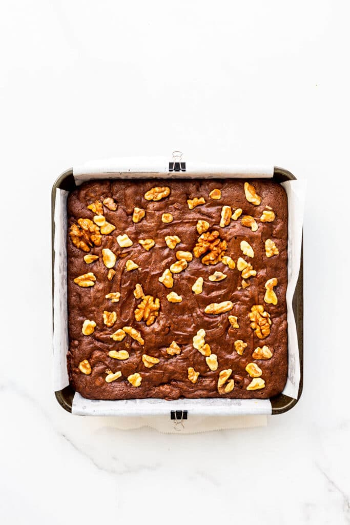 A pan of brownies with walnuts, freshly baked.