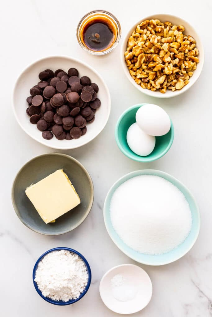 Ingredients needed to make brownies with walnuts, measured out and ready to be mixed.