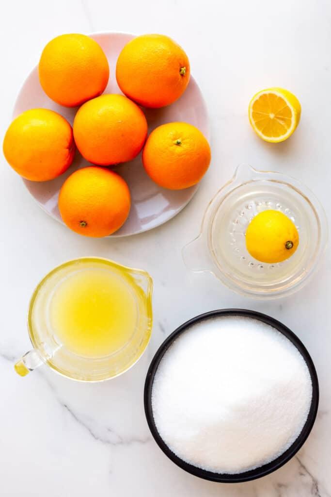 Ingredients to make homemade orange marmalade measured out.