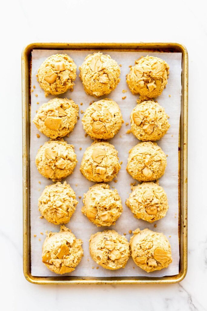 A sheet pan with scoops of maple cookie dough to be chilled before baking.