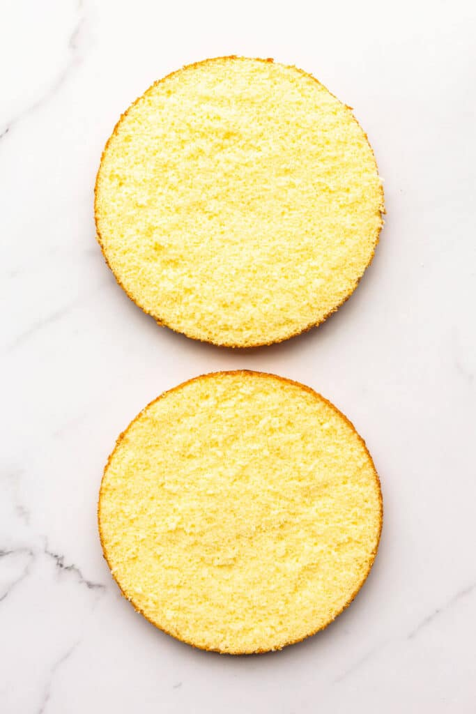 Sponge cake split into two equal layers.