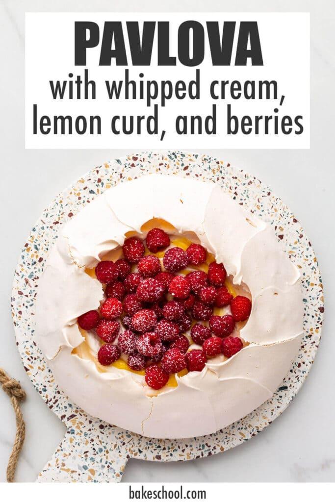 Pavlova cake filled with whipped cream, lemon curd, and raspberries.