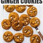 Freshly baked ginger cookies on a cooling rack.