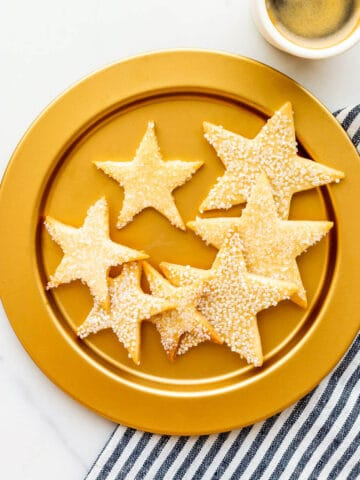 A gold plate of sugar cookie stars.