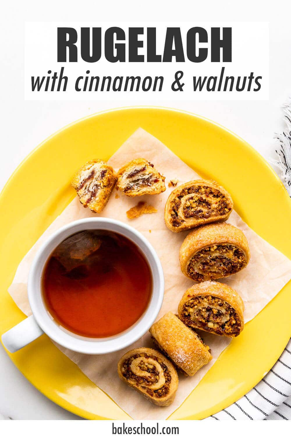 Rugelach on a yellow plate with a cup of tea.