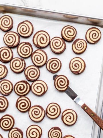 A sheet pan of freshly baked pinwheel cookies.