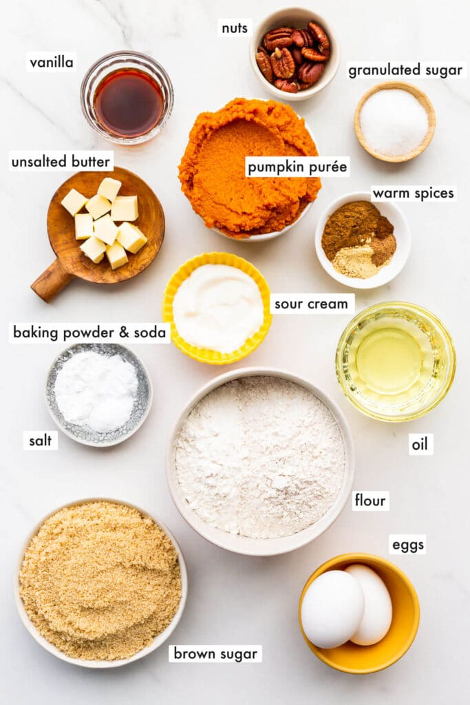 Ingredients to make pumpkin muffins from scratch, measured out and ready to be mixed.